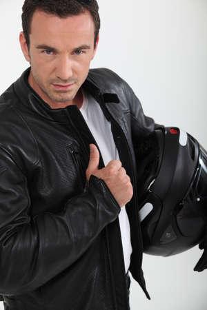 Biker holding helmet photo