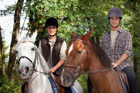 Young people horseriding Stock Photo - 10747300