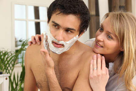 shave: Man shaving in his bathroom Stock Photo