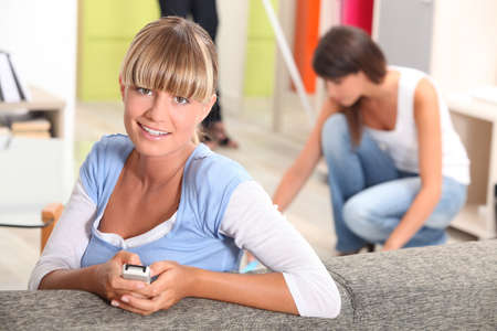 young woman with remote control Stock Photo - 10747379