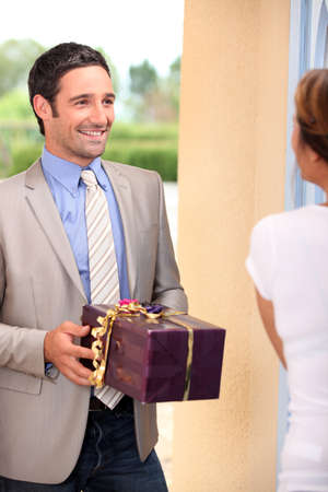 Man delivering present to woman photo