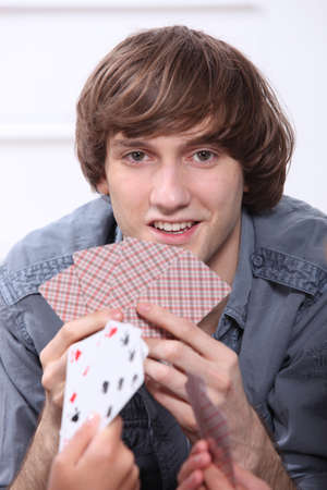 Teenage boy playing cards Stock Photo - 10747071