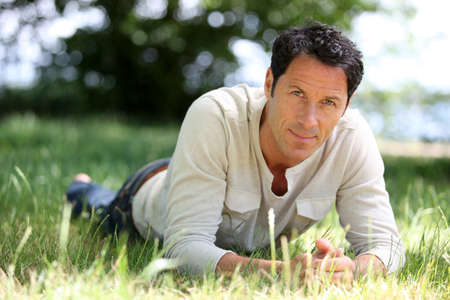 men 45 years: Man lying on the grass