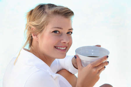portrait of a woman with bowl of coffee Stock Photo - 10746815
