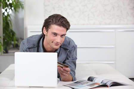 online store: Man using a credit card to buy online