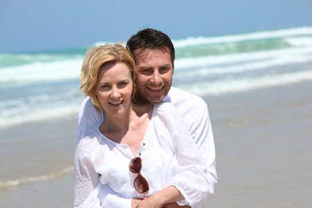 Couple hugging on the beach Stock Photo - 10746206