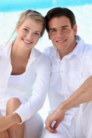 Young couple wearing white with a blue sky background Stock Photo - 10747266