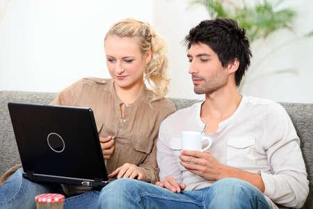 Couple on laptop Stock Photo - 10747279