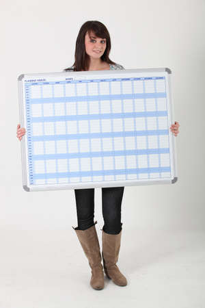 Young woman with a planning board Stock Photo - 10746816