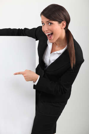 businesswoman holding a blank poster Stock Photo - 10746745