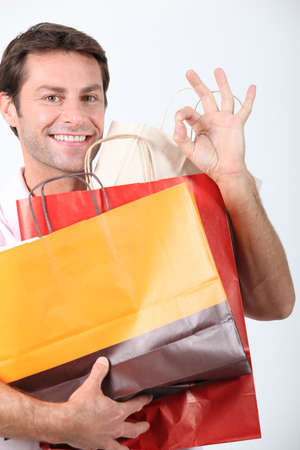 Man holding shopping bags 版權商用圖片
