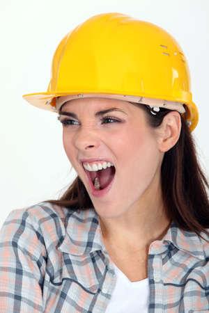 Female builder shouting Stock Photo - 10747292