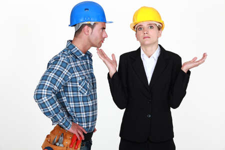 Angry foreman with helpless woman entrepreneur Stock Photo - 10746211