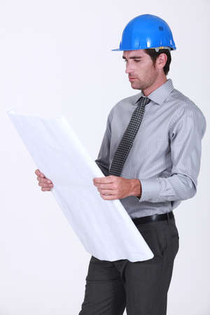 business skeptical: An architect checking his plans. Stock Photo