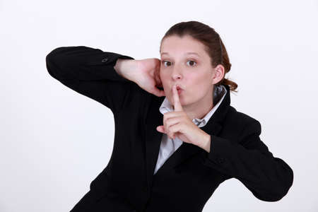 Businesswoman shushing Stock Photo - 10747067