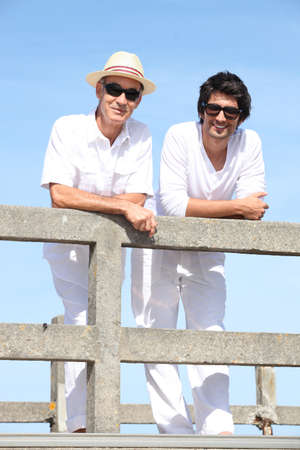 crenelation: Father and son stood on jetty