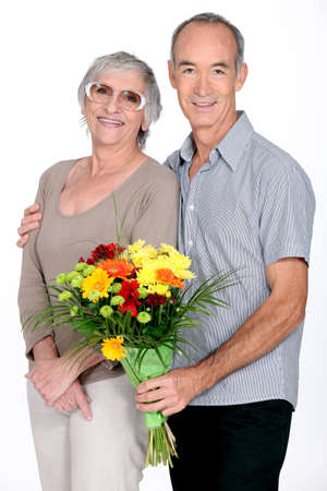 Husband giving wife flowers Stock Photo - 10747396