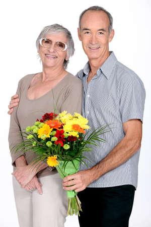 Husband giving wife flowers photo