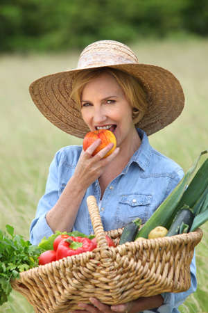 woman with vegetables basket Stock Photo - 10747282