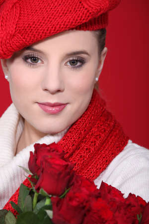 A portrait of a woman with red roses. Stock Photo - 10747192