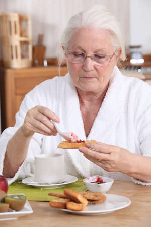 senior woman eating breakfast Stock Photo - 10746214