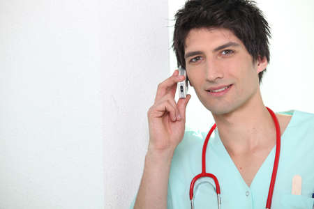 Medic using a cell phone Stock Photo - 10747299