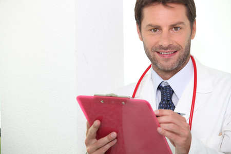 Hospital doctor with clipboard Stock Photo - 10746222