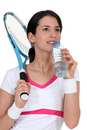 Woman tennis player drinking water Stock Photo - 10746208