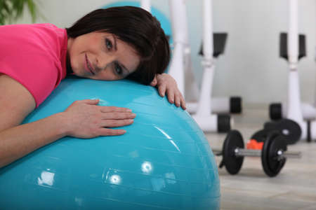 woman doing exercises with a ball Stock Photo - 10747276