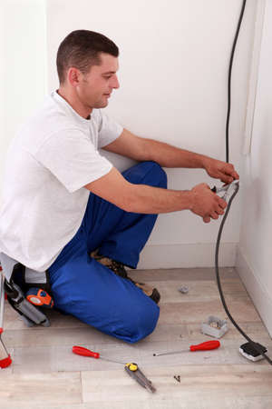Worker cutting a wire photo
