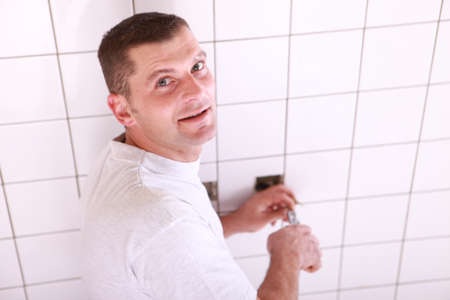 Man wiring a wall socket photo