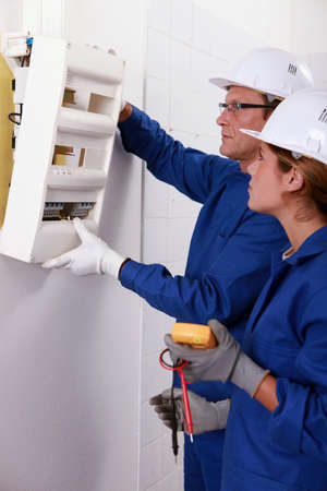 fusebox: Electrical team installing a fusebox