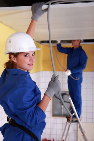 yourselfer: female plumber apprentice and tutor at work