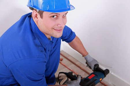 Plumber drilling photo