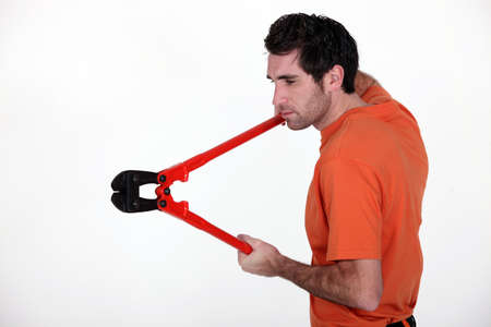 Man holding bolt-cutters Stock Photo - 10782669
