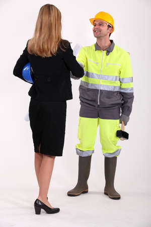 gaga: Businesswoman shaking the hand of a tradesman Stock Photo
