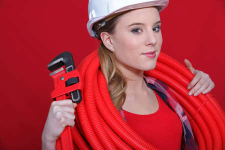 Red themed female plumber Stock Photo - 10783517