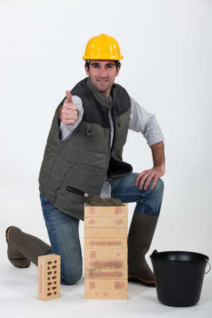 wellies: Bricklayer giving his sign of approval Stock Photo