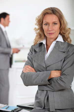 business woman standing: Businesswoman looking serious