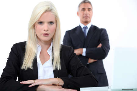 Young businesswoman with older male colleague photo