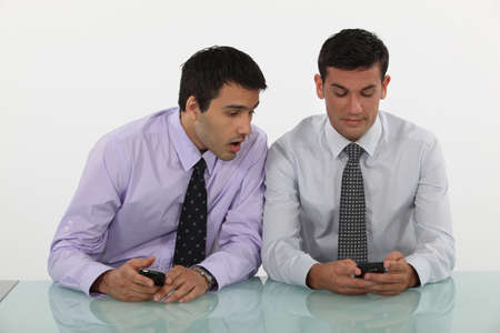Two men with cellphones Stock Photo - 10782840
