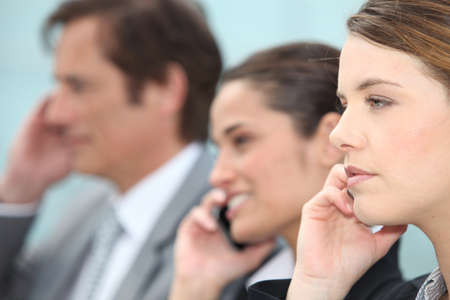 Businessmen and women on the phone. Stock Photo - 10782796