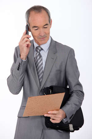 55 to 60: Businessman on mobile phone