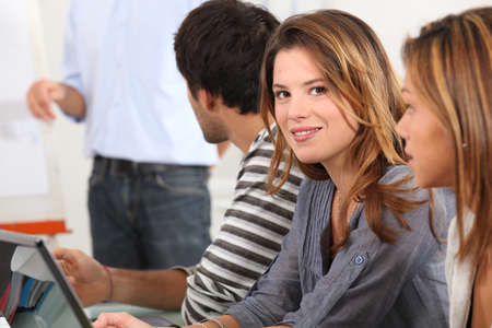 Attractive young woman in a meeting Stock Photo - 10783560