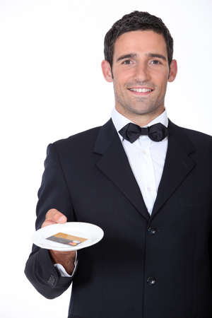 A waiter presenting a credit card. Stock Photo - 10783271