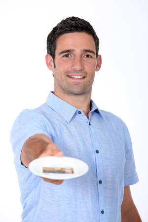 Man paying restaurant bill with credit card photo