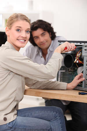 female technician repairing a computer Stock Photo - 10783527