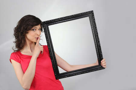 picture person: woman holding a picture frame