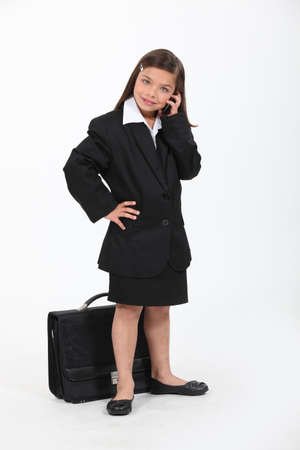 little girl dressed as a businesswoman