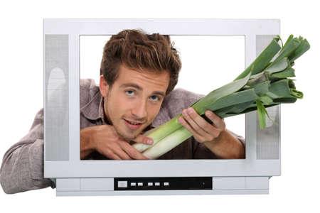 a man giving leeks through a screen Stock Photo - 10783545